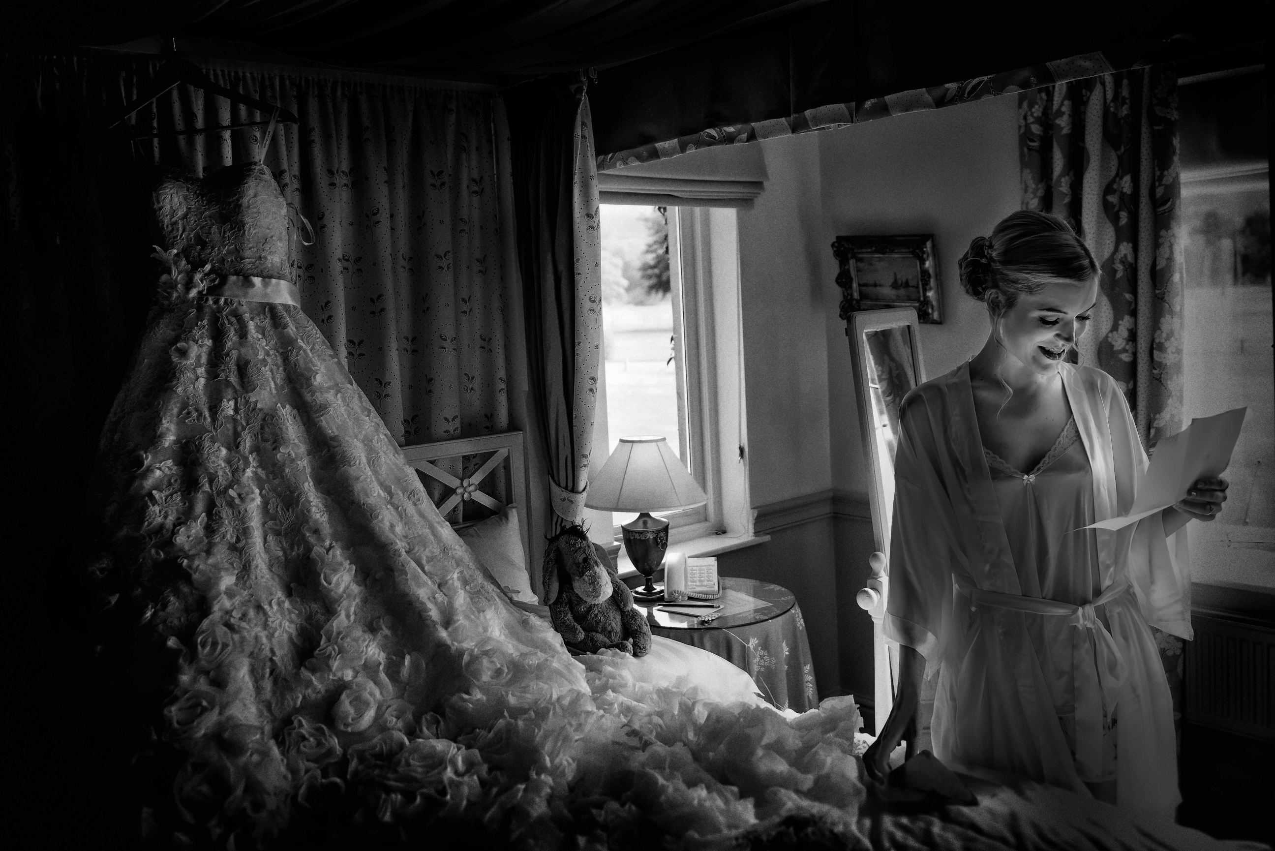 Lancashire wedding photograph of a bride reading a love letter