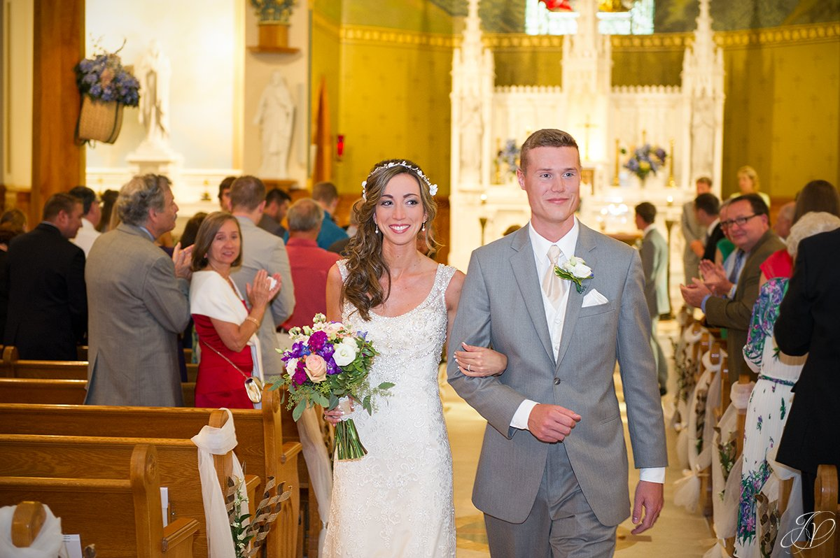 bride and groom exiting church ceremony
