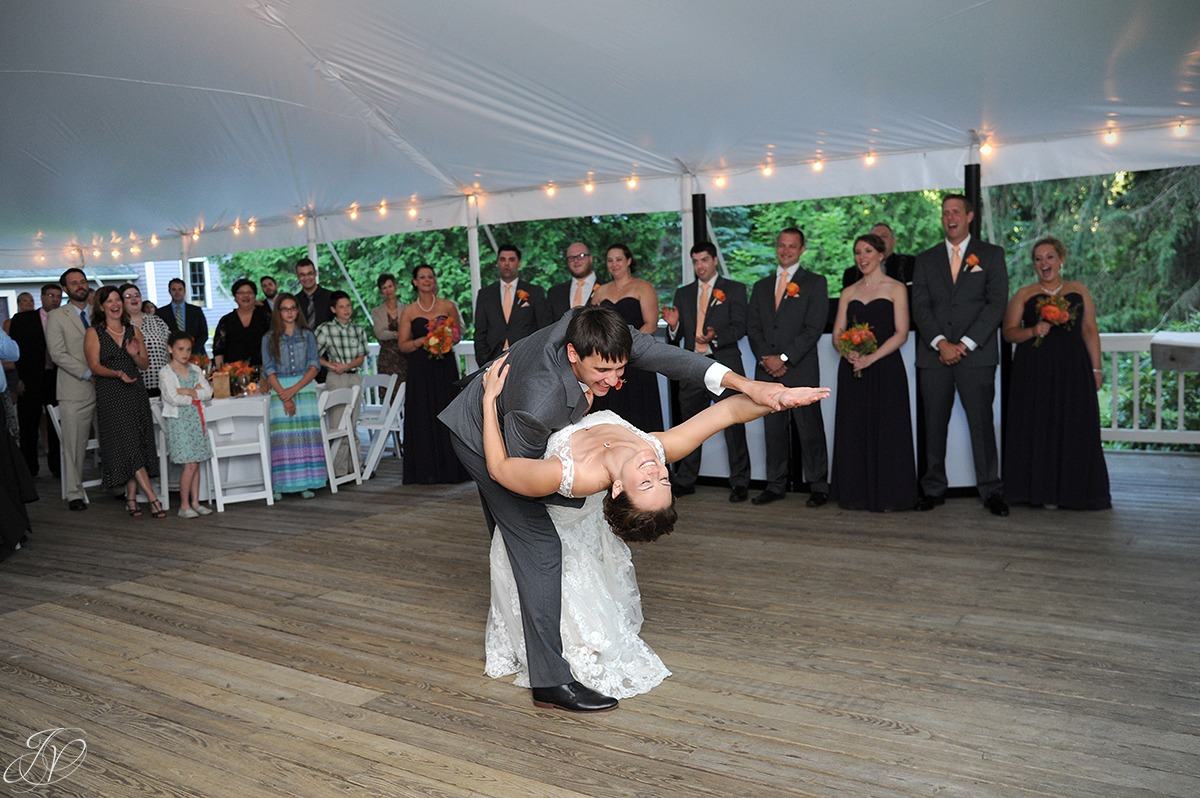 photo of groom dipping bride during their first dance