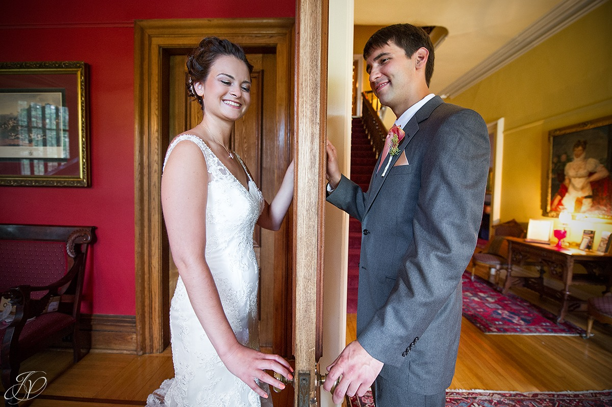 bride and groom on opposite sides of a door