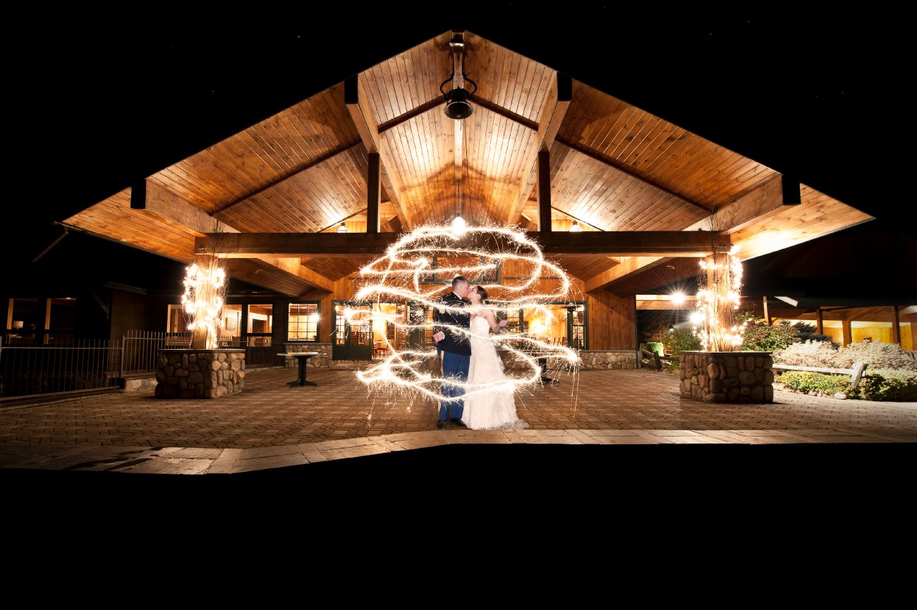 sparkler photos, painting with light, outside bride and groom night photos, Lake Placid Wedding Photographer, lake placid wedding, reception detail photos, Wedding at the Lake Placid Crowne Plaza