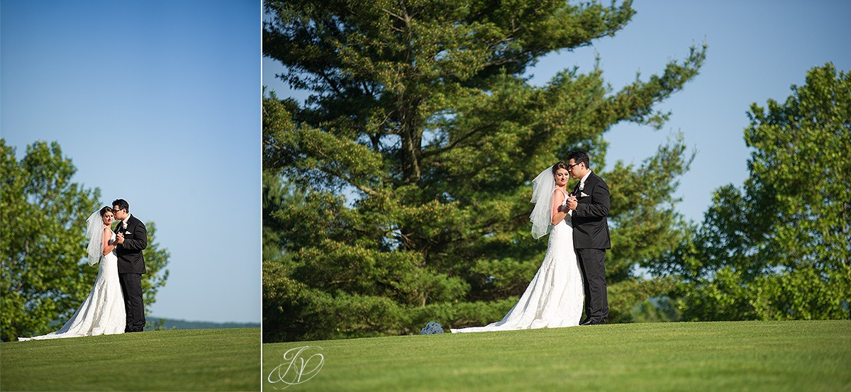 groom kissing bride cheek on golf course