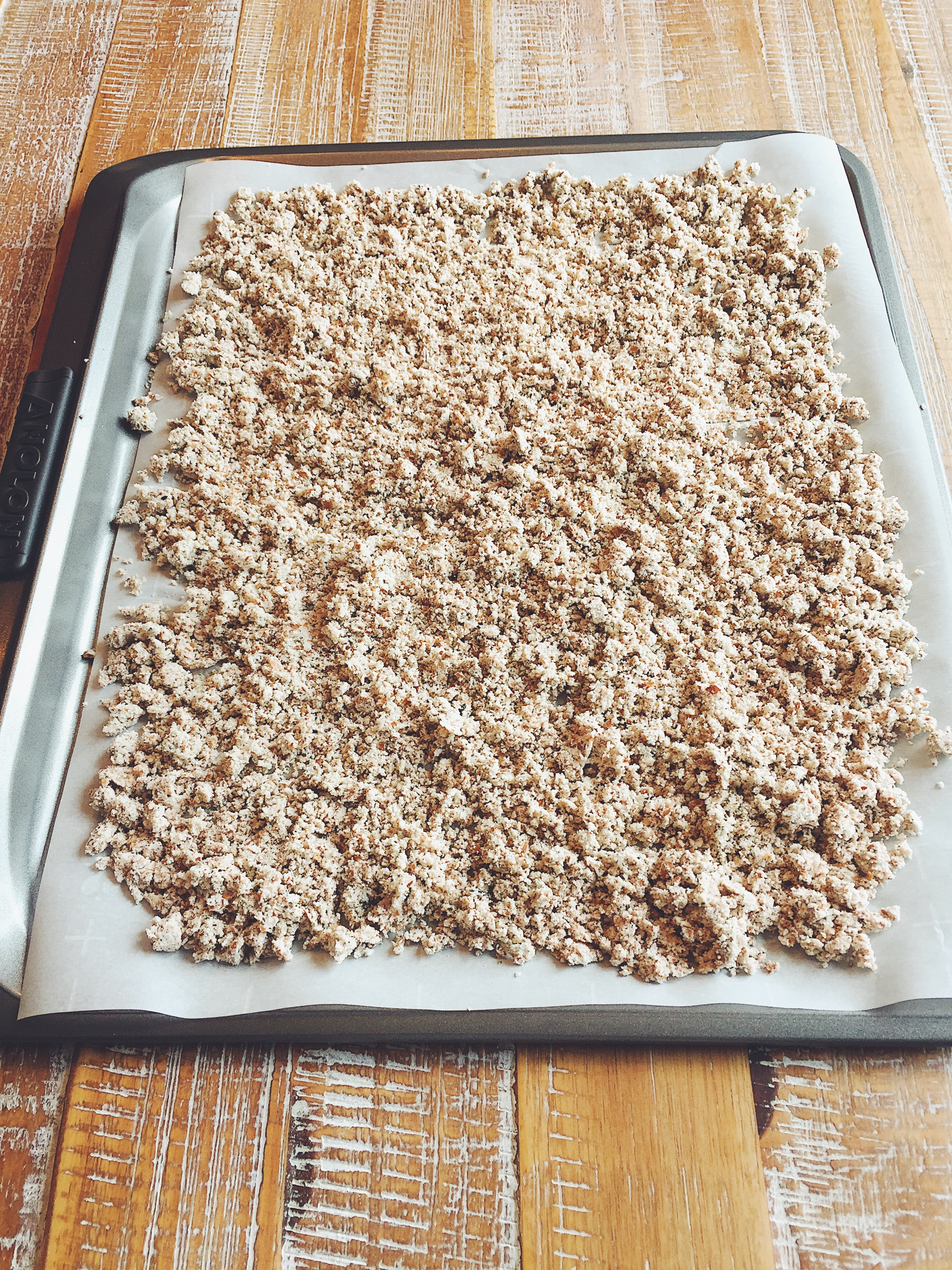 Spread the almond meal onto the parchment paper