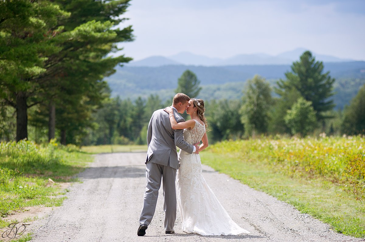 bride and groom almost kissing lake placid nature