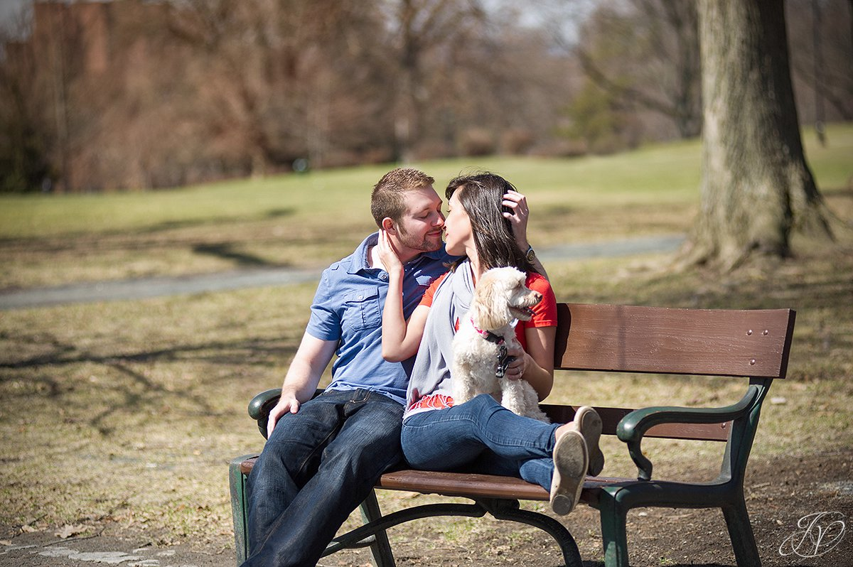 couple kissing in park, pet engagement photo, engagement photos at washington park albany, albany engagement photography, downtown engagement session, albany portrait photography, engagement session in washington park