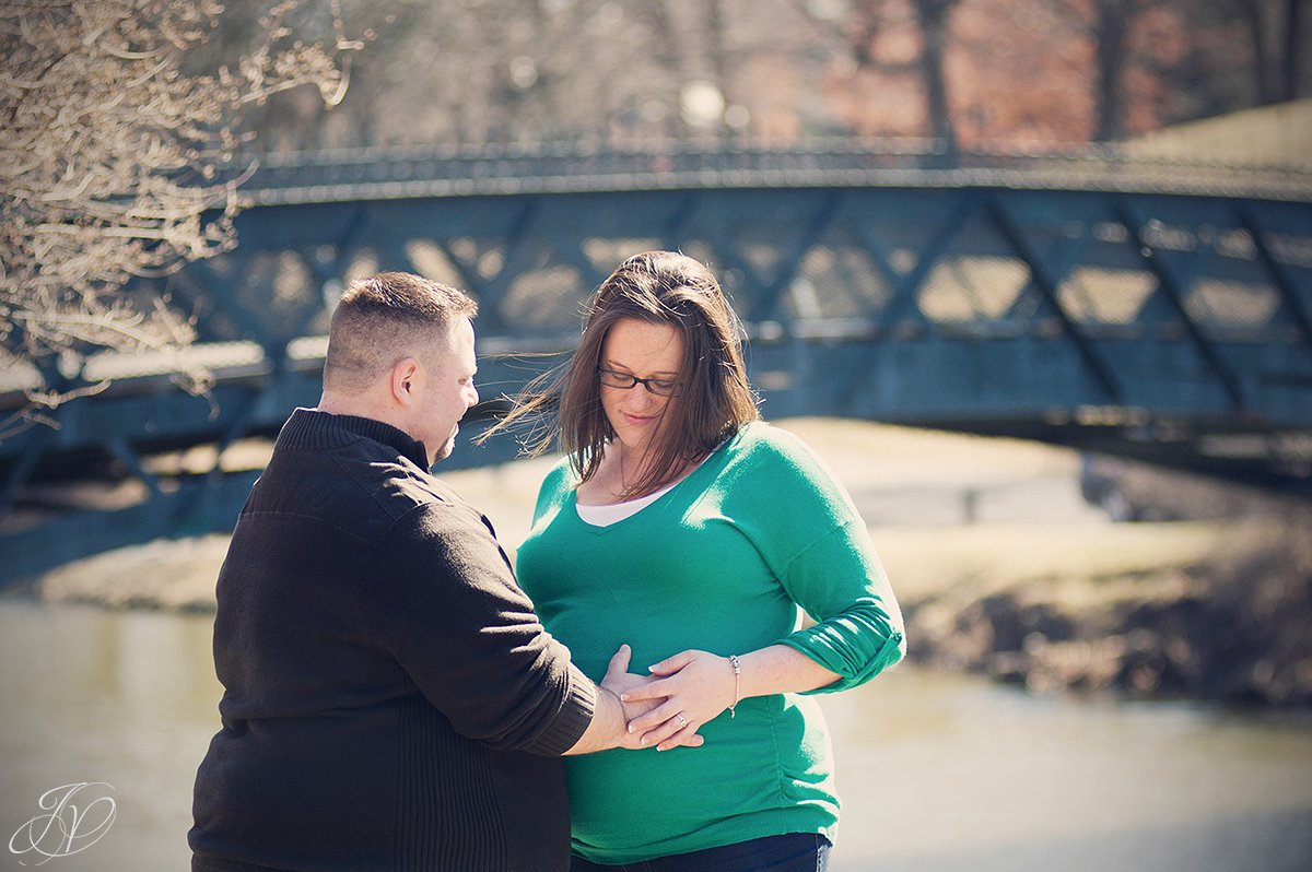 father to be touching stomache, expecting parents in washington park, expecting mother and chocolate lab, maternity session washington park, maternity and pet portraits in washington park albany, albany maternity photographer, albany maternity photos