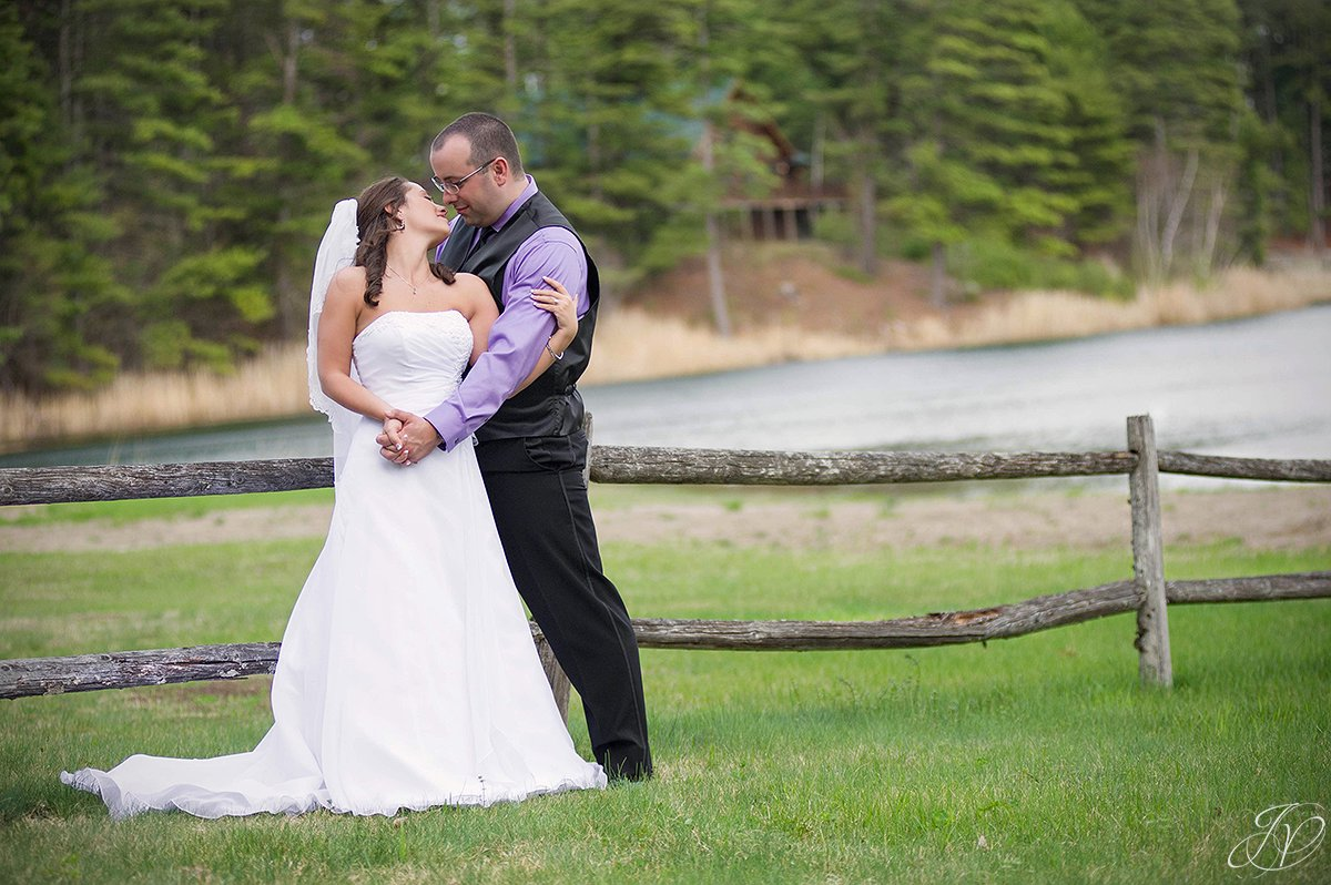 romantic bride and groom photo with lake view
