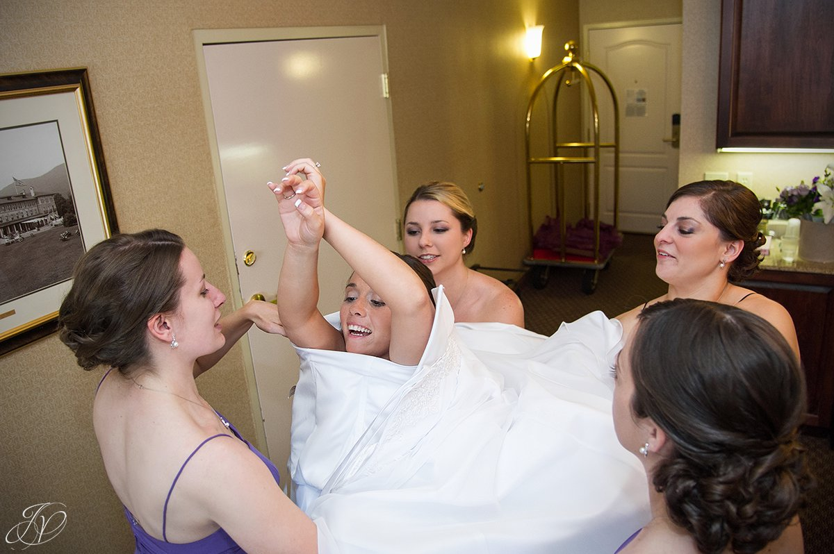unique angle of bride getting dressed