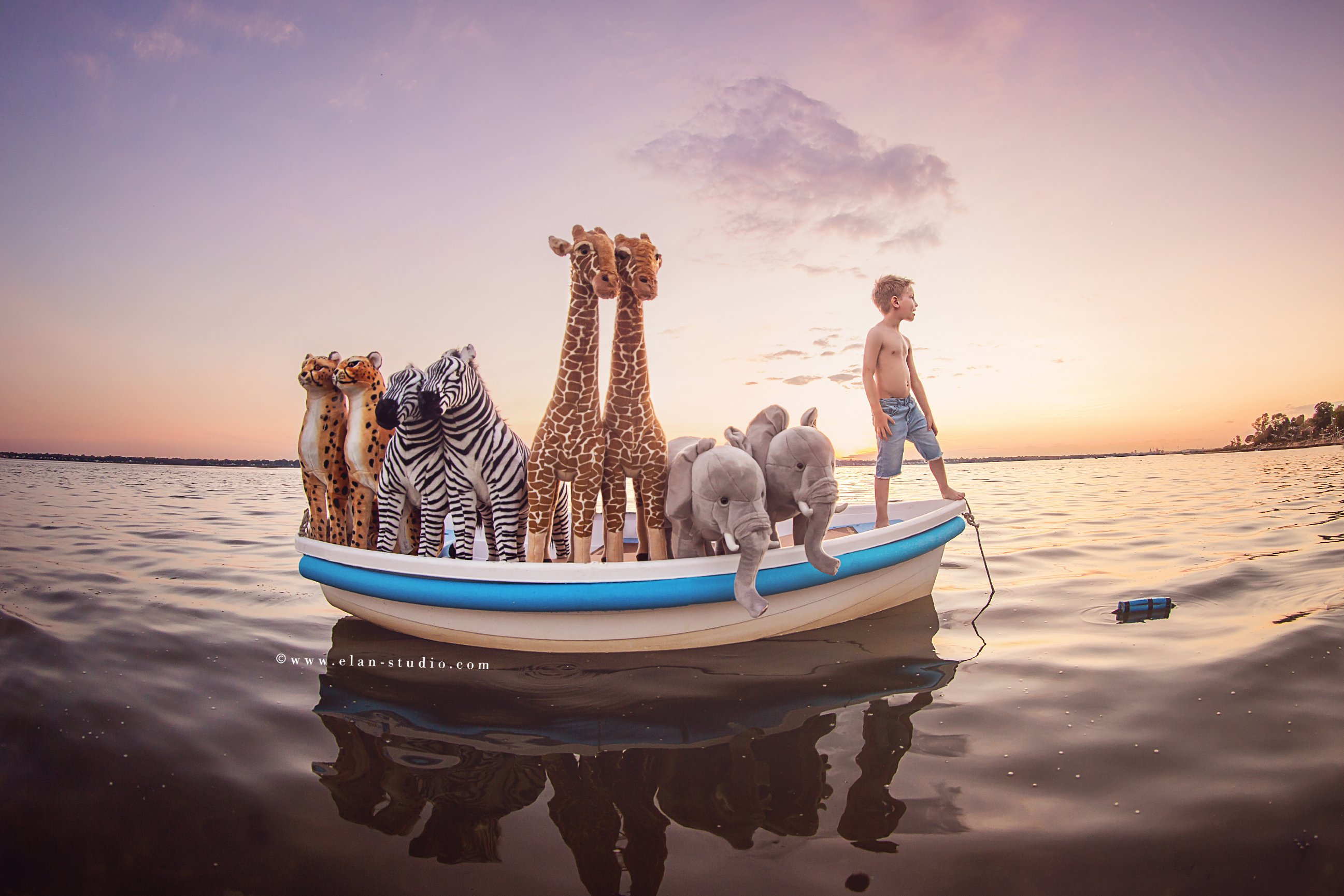 Noah's Ark inspired image with little boy and stuffed animals in boat