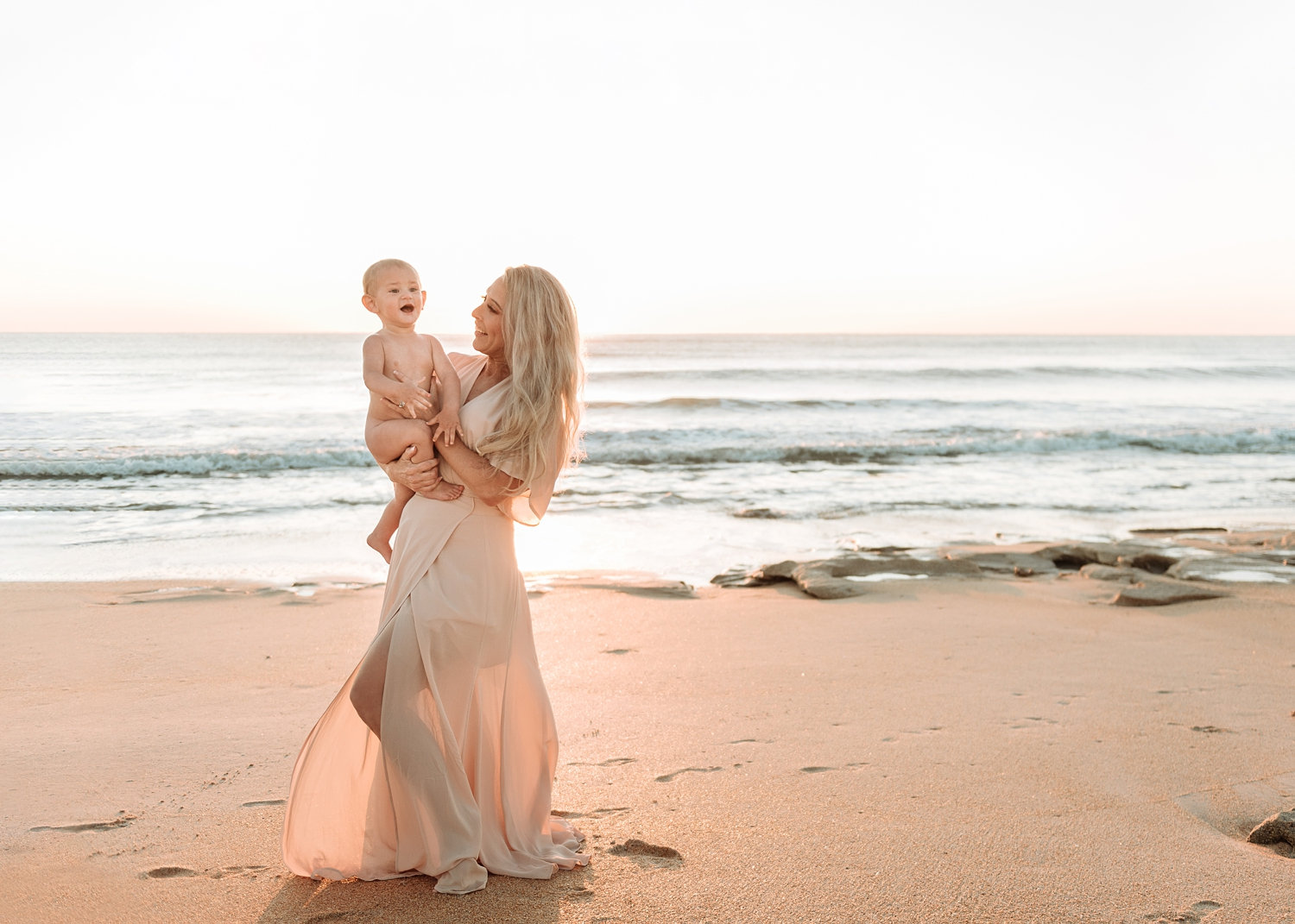gorgeous blonde mother and baby boy dancing on the beach, Rya Duncklee