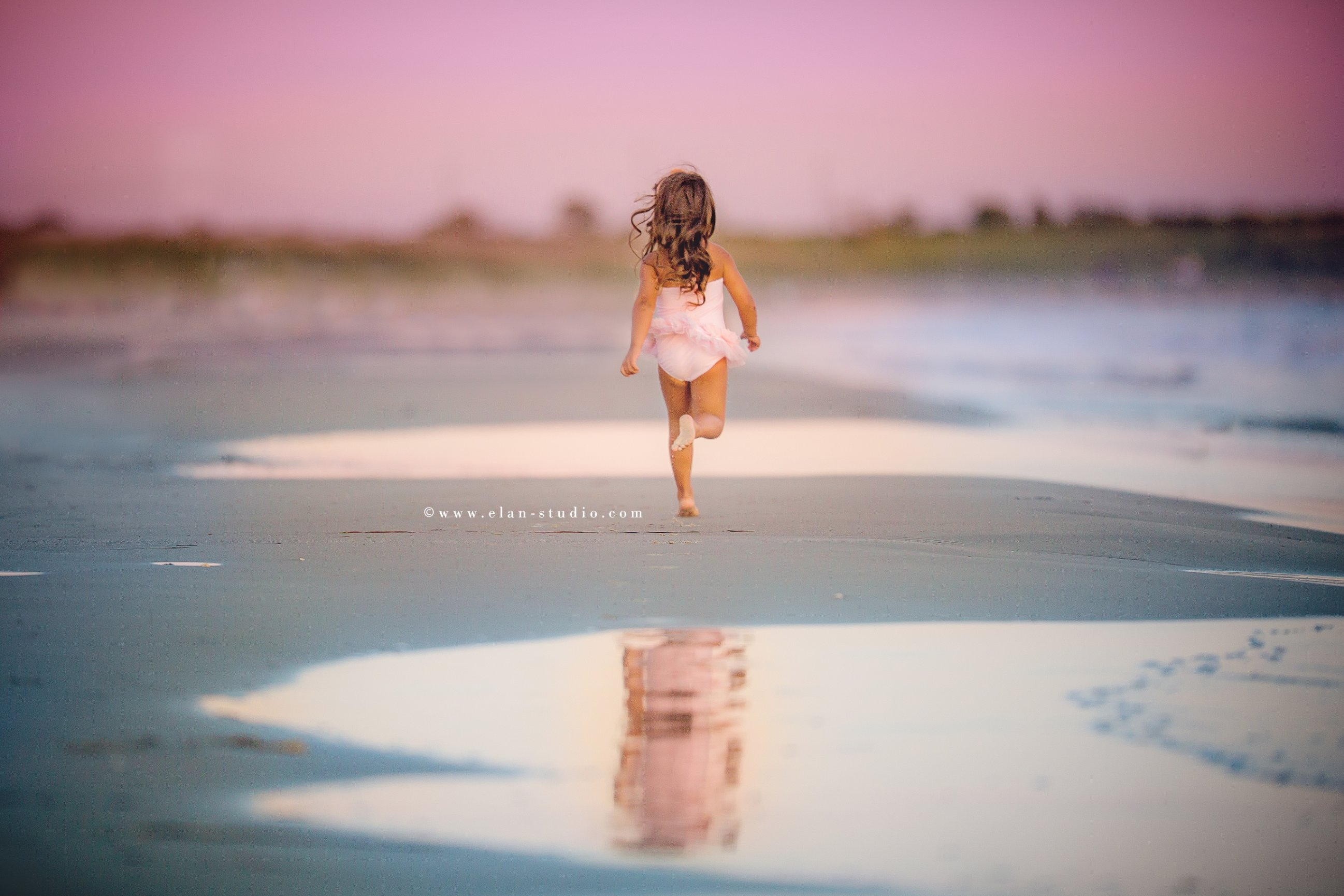 little girl running away from camera, Bristol, Rhode Island beach