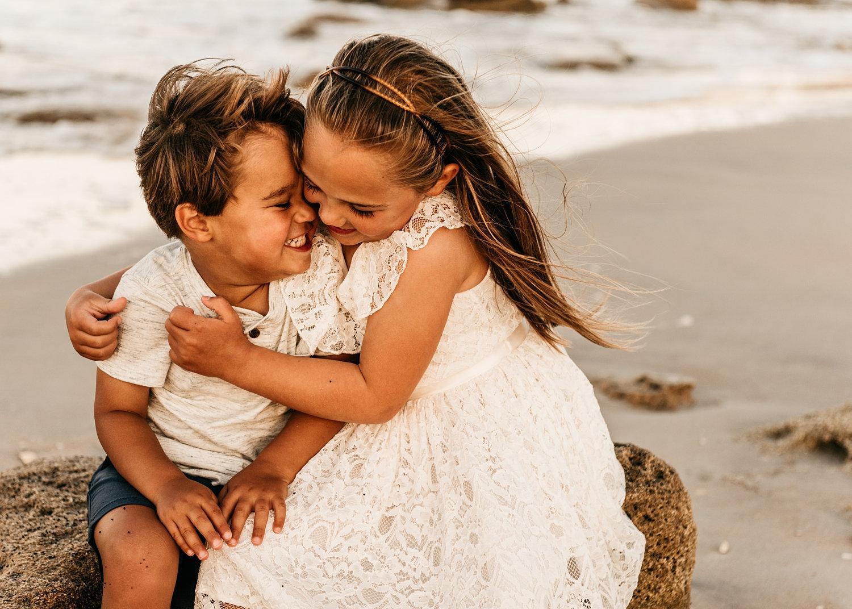 little girl hugging her little brother on the beach, Saint Augustine Beach, Florida